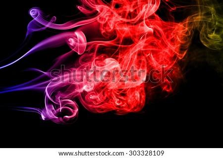 Abstract color smoke on black background, smoke background,colorful ink background,blue,red,yellow, beautiful smoke #303328109