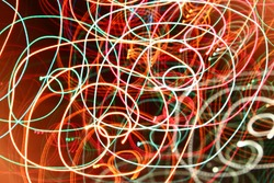 abstract color swirl garland lights. Blurred glowing on dark background