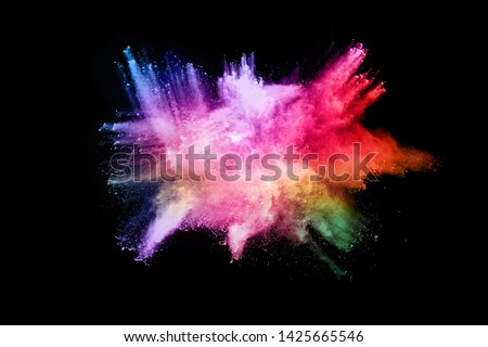 abstract colored dust explosion on a black background.abstract powder splatted background. #1425665546