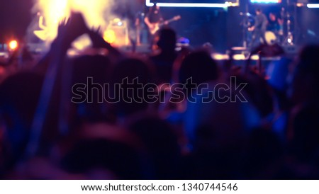 abstract colorful background audience in public concert. #1340744546