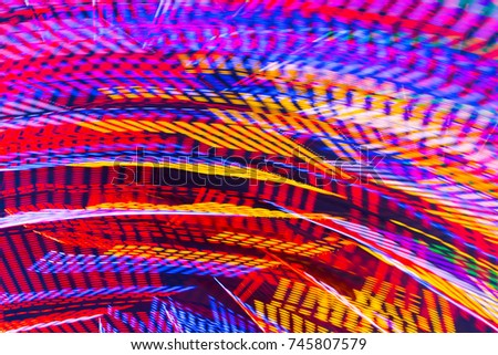 Abstract colorful background. Blured Ferris Wheel lights #745807579