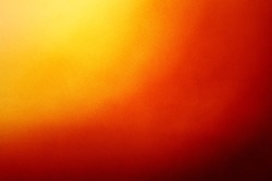 Abstract colorful background with grunge noise grain texture and vivid radial color gradient of red, orange, brown and yellow from corner
