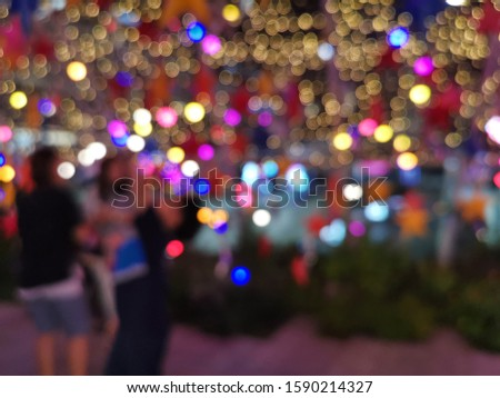 Abstract colorful background with light garland.Beautiful decorated christmas tree. Chrismas tree background.Chrismas tree colorful background bokeh blurred background in chrismas day