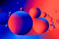 Abstract colorful background with oil on water surface. Oil drops in water abstract psychedelic. Space and universe planets styled psychedelic abstract image