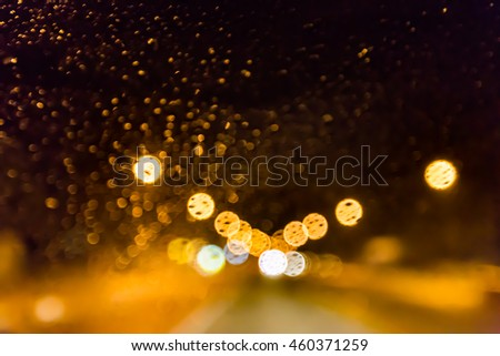 Abstract colorful bokeh - water on window glass #460371259