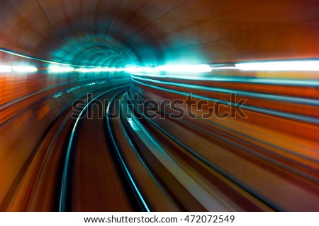 Abstract colorful concentric light trail accelerating through a tunnel. #472072549