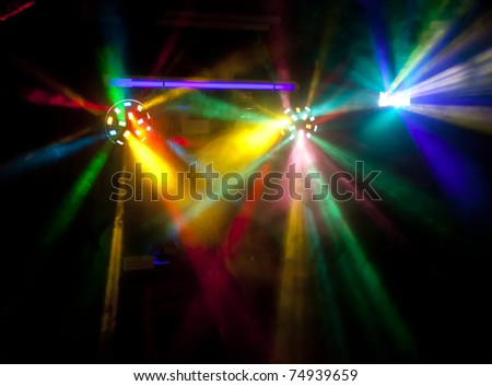 Abstract colorful disco lights in smoke - stock photo