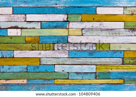 Abstract colorful painted wood wall - stock photo