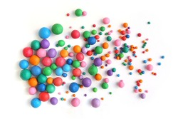 Abstract  colorful plasticine balls isolated on white background. Many balls made of modeling clay,
