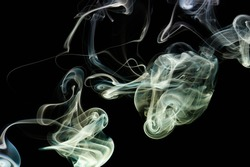 Abstract colorful smoke curl with smooth shape in black backdrop