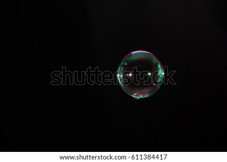 Abstract colorful soap bubble on black background #611384417