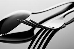 Abstract composition for kitchen. Fork and spoon with reflection.