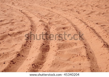 abstract composition for tracks on sand from tire in desert