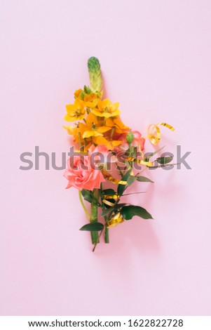 Abstract Composition, orange tropical flower, pink roses copy space on pink background