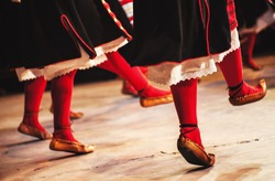 Abstract composition showing legs dressed in Serbian traditional clothe dancing in folklore.