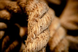 Abstract composition, texture details of thick and strong rope isolated on blurred background,