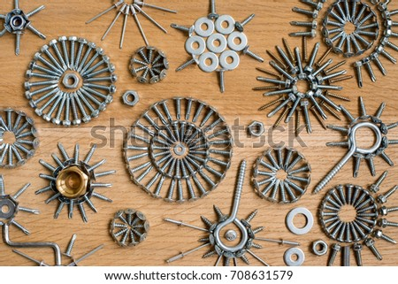 Abstract composition with fastening elements on the wooden background, screw, nails, bolt, head, workshop