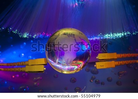 Abstract computer with technology earth globe against fiber optic background