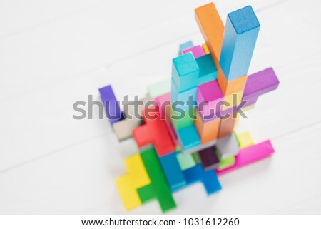 Abstract construction from wooden blocks with copy space. The concept of logical thinking, geometric shapes.