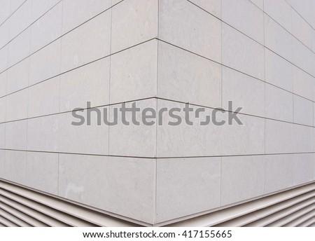 Abstract corner. Building corner of gray tiles.