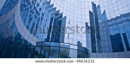 Abstract corporate facade with reflections - La Defense, Paris - France.