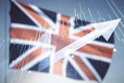 Abstract creative financial diagram and upward arrow hologram on flag of Great Britain and blue sky background, growth and development concept