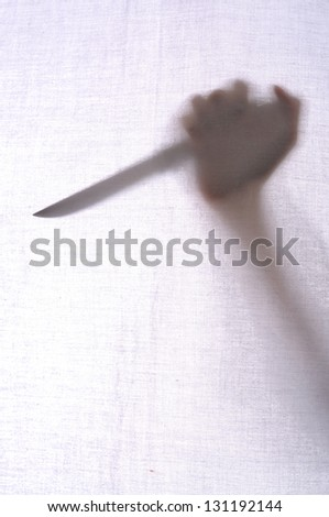 Abstract crime background. Silhouette of someone holding knife
