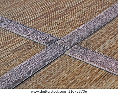 abstract cross sign on yellow brick wall, modern architecture details