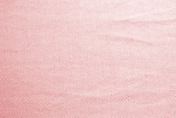 Abstract crumpled pink color fabric texture background.
