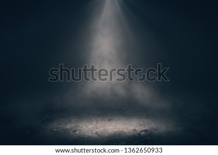 Abstract dark backdrop with spotlight and smoke. Stage concept