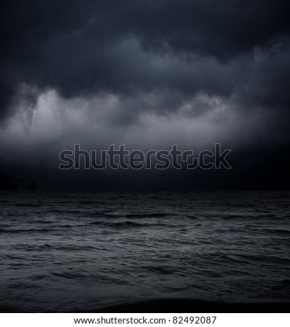 abstract dark background. sea waves against the black sky