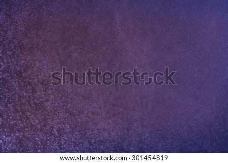abstract dark bokeh lights background , purple,black and subtle gold. defocused background