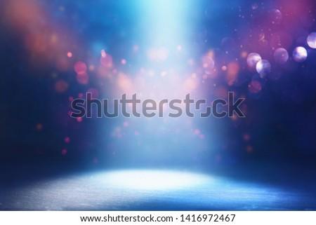 abstract dark concentrate floor scene with mist or fog, spotlight, glitter light bokeh for display