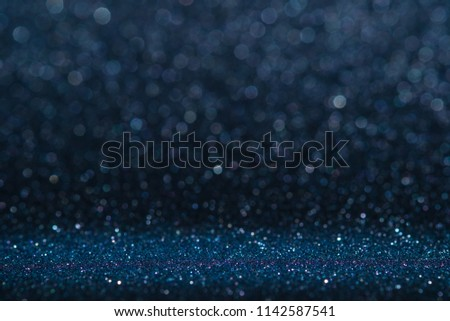 Abstract dark navy blue sparkling glitter wall and floor perspective background studio with blur bokeh.luxury holiday backdrop mock up for display of product.holiday festive greeting card - Shutterstock ID 1142587541