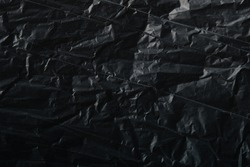 abstract dark texture of crumpled plastic film for Wallpaper and backgrounds