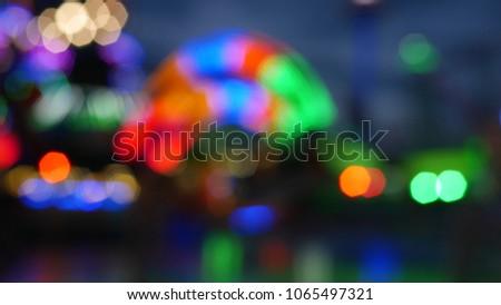Abstract defocus bokeh background light night at amusement park. #1065497321