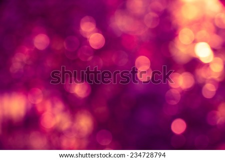 Abstract defocused background with purple and gold circular blurry bokeh