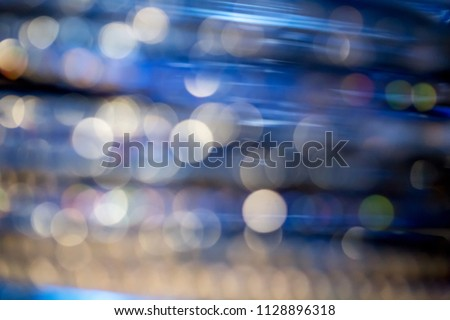 Abstract defocused blue, navy blue and gold blurred background with bokeh. #1128896318