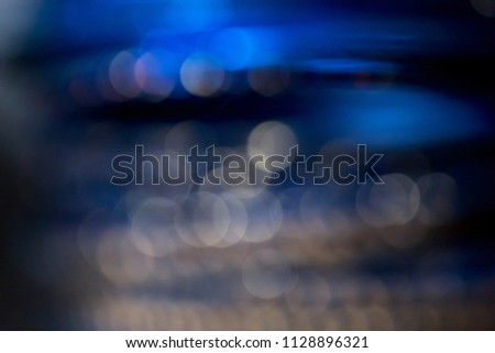 Abstract defocused blue, navy blue and gold blurred background with bokeh. #1128896321