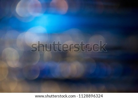 Abstract defocused blue, navy blue and gold blurred background with bokeh. #1128896324