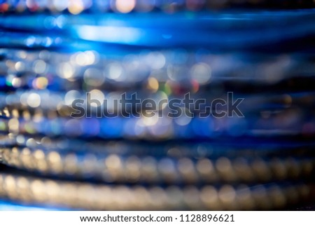 Abstract defocused blue, navy blue and gold blurred background with bokeh. #1128896621