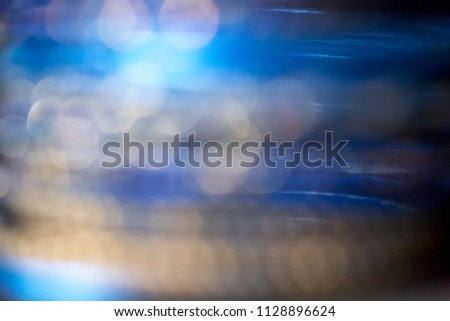 Abstract defocused blue, navy blue and gold blurred background with bokeh. #1128896624