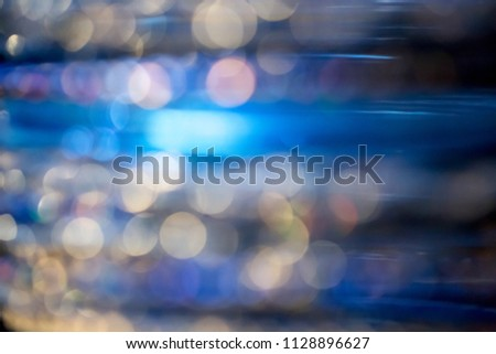 Abstract defocused blue, navy blue and gold blurred background with bokeh. #1128896627