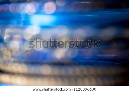 Abstract defocused blue, navy blue and gold blurred background with bokeh. #1128896630