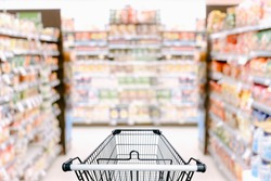 Abstract Defocused Blurred of Consumer Goods and Shopping Cart in Supermarket Store, Shop Trolley Basket in Department Store. Business Retail Customer Shopping Mall Service, Convenience Supermarkets