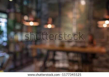 Abstract defocused bokeh in coffee shop, Blurred background #1177345525