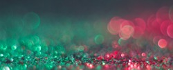abstract defocused round shaped green and red lights on black background