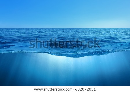Abstract design of tropical sea water split line with underwater and sky #632072051