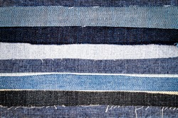 Abstract different torn jeans stripes texture background. Jeans texture. Striped jeans background. Denim jeans texture.