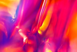 Abstract digital intense night club background of multicolored vibrant festive smooth orange and magenta colors with blurred fluid lights